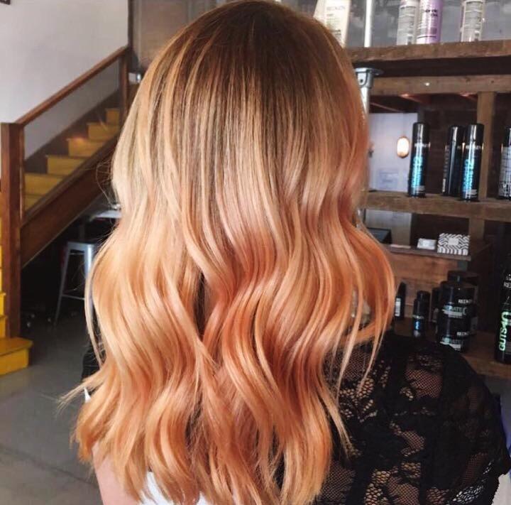 Peach hair balayage at brixton salon in London against modern salon background
