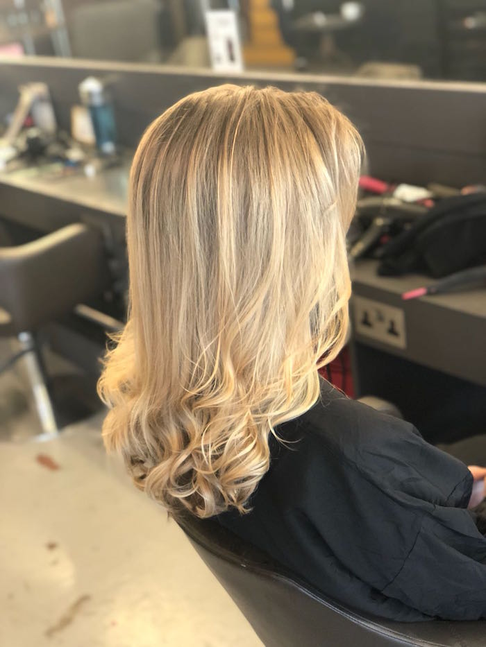 golden blonde highlights with a blow dry in the Live True London Brixton salon